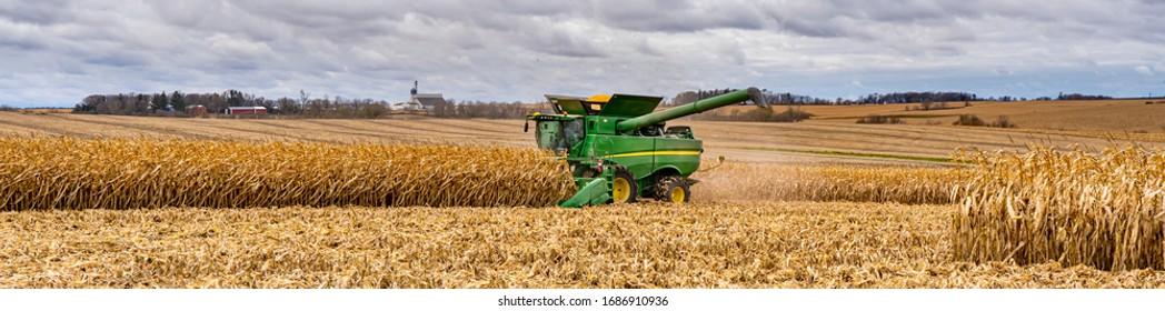 Kenyon, Minnesota - 11/2/2019:  A panorama image of a corn harvesting combine  near Kenyon, Minnesota.