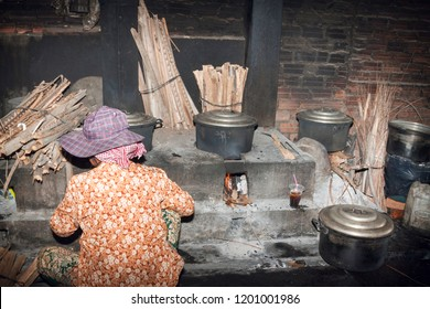 Kep, Cambodia, Asia - May 4, 2014:A Scene of local woman cook boiling crabs in special fireplace at Crab Market in Kep, as traditional occupation for make a living. The place that crabs are cooked.