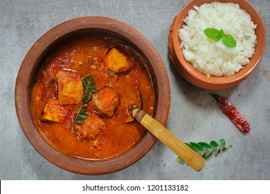 Kerala Alleppey fish Curry / Tuna cooked in spicy red sauce served in Earthen Pot with rice, Overhead view