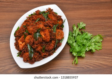 Kerala chicken fry or chicken 65 hot and spicy dish garnished with curry leaves Kerala. a popular authentic roasted dish of South India. fried in a coating of Indian spices..