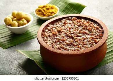 Kerala cuisine- organic red rice congee or kanji served in clay bowl.
