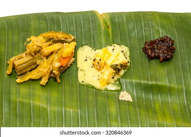 Kerala curries avial, pulissery,injicurry in banana leaf.Onam Sadhya is Kerala vegeterian lunch served on a banana leaf on the occasion of festival Onam.