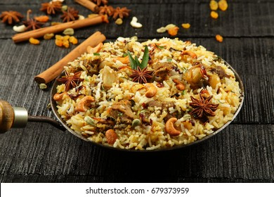 Kerala food- Malabar mutton biriyani served with spices.