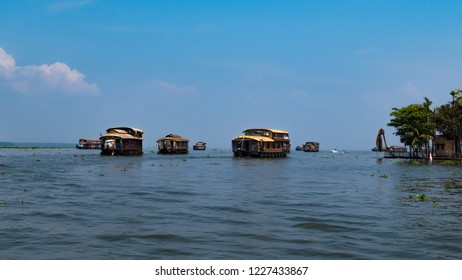 Kerala houseboat rowing in Alleppey under the blue sky