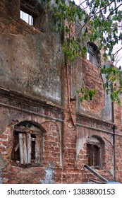 , Kerala, India, April 27, 2019: Delapidated Dutch-era godowns in the old town of Cochin. Weathered bricks and timber. Urban decay and renewal.