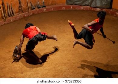 KERALA, INDIA - JANUARY 18, 2016: Indian men performing Kalaripayattu marital art in Kerala, India. Kalaripayattu is an ancient form of martial art of Kerala dating back to almost 2000 years.