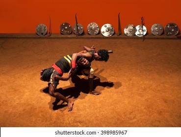 KERALA, INDIA - JANUARY 18, 2016: Indian fighters performing Kalaripayattu marital art in Kerala, India. Kalaripayattu is an ancient form of martial art of Kerala dating back to almost 2000 years.
