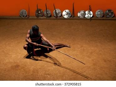 KERALA, INDIA - JANUARY 19, 2016: Indian man performing Kalaripayattu marital art in Kalaripayattu Center in Kerala, India. Kalaripayattu is an ancient form of martial art of Kerala.