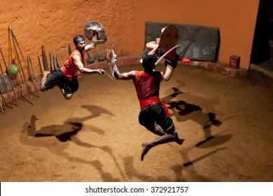 KERALA, INDIA - JANUARY 19, 2016: Indian men performing Kalaripayattu marital art in Kalaripayattu Center in Kerala, India. Kalaripayattu is an ancient form of martial art of Kerala.