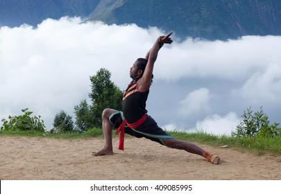 KERALA, INDIA - JANUARY 19, 2016: Indian men performing outdoors Kalaripayattu training in Kerala, India. Kalaripayattu is an ancient form of martial art of Kerala dating back to almost 2000 years