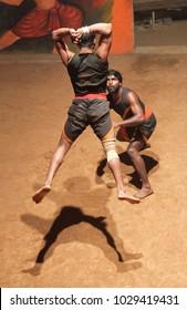 KERALA, INDIA - NOVEMBER 11, 2016: Indian fighters performing Kalaripayattu marital art at training centre. Kalaripayattu is an ancient form of martial art of Kerala