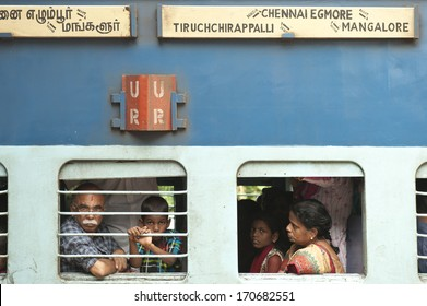 KERALA, INDIA - NOVEMBER 28: Unidentified passengers inside Indian Railway train on November 28, 2011 in Kerala, India. Indian Railways carries about 7,500 million passengers annually.