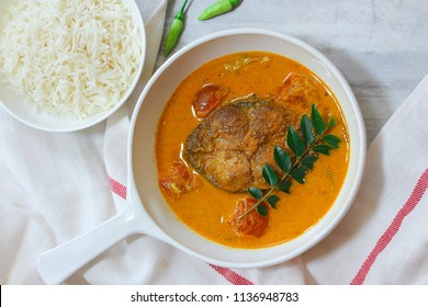 Kerala King Fish Curry served with rice, overhead view