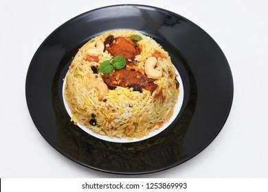 Kerala Kozhikode Chicken Biryani, hot and spicy traditional dish in India prepared with basmati rice, chicken, nuts and raisins. festival dish for ramadan kareem, Eid-Ul-Adha iftar party, christmas
