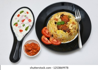 Kerala Malabar Chicken Biryani, hot and spicy traditional dish in India prepared with basmati rice, chicken, nuts and raisins. festival dish for ramadan kareem, Eid-Ul-Adha iftar party, christmas
