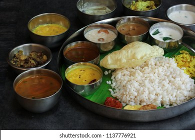 Kerala Onam Feast or Traditional South Indian Vegetarian Thali on round steel plate