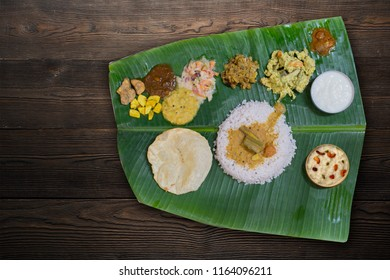 KERALA ONAM SADYA ON A WOODEN BACKGROUND