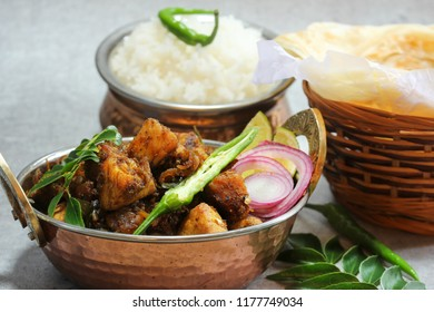 Kerala Pork Fry or Roast served with Parotta and rice, selective focus