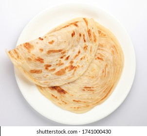 Kerala Porotta , Malabari Parotta,   India. Popular street food use Maida flour in Kerala, Tamil Nadu, Sri lanka. Top view of South Indian food