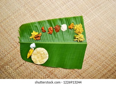 Kerala Sadya  South indian Vegetarian meal served in banana leaf, arial view, top view