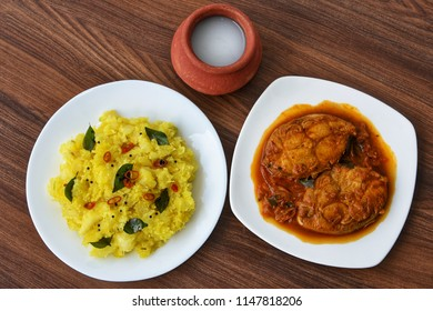 Kerala special Kappa Puzhukku prepared with grated coconut South Indian food with  spicy Fish curry, palm wine or toddy,  India. Cooked tapioca or Cassava root, Mandioca or Aipim root vegetable Brazil