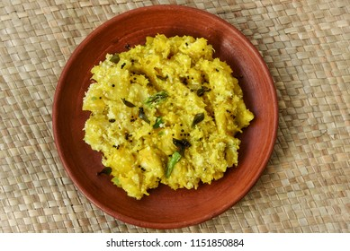 Kerala special Kappa Puzhukku prepared with grated coconut South Indian food serve with side dish spicy meat or fish curry, India. Cooked tapioca, Cassava root, Mandioca or Aipim root vegetable Brazil