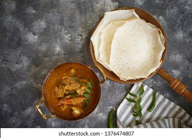 Kerala Spicy Crab curry served with Appam
