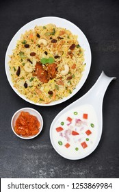 Kerala style Chicken Biryani, hot and spicy traditional dish in India prepared with basmati rice, chicken, nuts and raisins. festival dish for ramadan kareem, Eid-Ul-Adha iftar party, christmas
