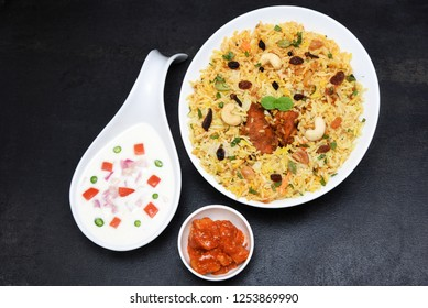 Kerala Thalassery Chicken Biryani, hot and spicy traditional dish in India prepared with basmati rice, chicken, nuts and raisins. festival dish for ramadan kareem, Eid-Ul-Adha iftar party, christmas