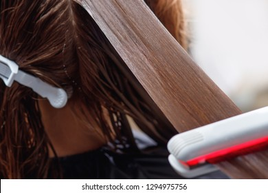 Keratin recovery hair and protein treatment pile with professional ultrasonic iron tool. Concept straighten spa