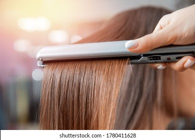 Keratin recovery and treatment with professional iron tool. Laminated long dark shiny hair closeup. - Shutterstock ID 1780411628