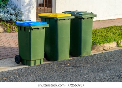 Kerbside waste bins ready for collection by local council in Australian suburb