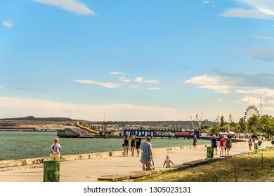 Kerch city, Republic of Crimea - July 17, 2018: Crimean Kerch promenade with walking peoples. Seafront near Sverdlova street.