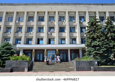 Kerch, Crimea, July, 13, 2016. People going out of Administrative office building in the city of Kerch on the street of Kirov, the house 5