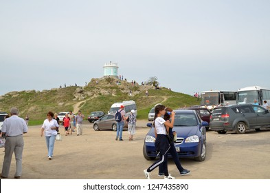 KERCH, CRIMEA - SEPTEMBER 23, 2018: Tourists walk on Mithridates mountain, view the Eternal Flame complex on  its top and other sights