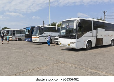 Kerch, Republic of Crimea, Russia - July 18, 2017: Buses for the transportation of passengers following a single ticket in the parking lot in the port of Crimea