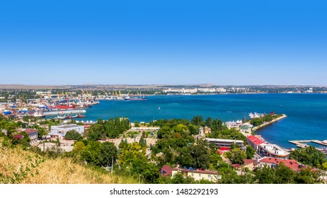 Kerch, Russia - 13 August 2019: magnificent summer landscape overlooking the sea and the port from the waterfront in the city of Kerch from mount Mithridates