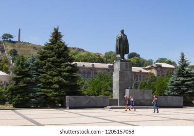 KERCH, RUSSIA - JULY 24: Monument to Lenin in the square named after Vladimir Lenin against the backdrop of Mount Mithridates on July 24, 2018 in Kerch.