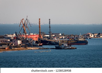 The Kerch Strait is clogged with vessels of different purpose, Black sea and Azov. The ship at anchor. A small port with fishing trawlers and a fish receiving base.