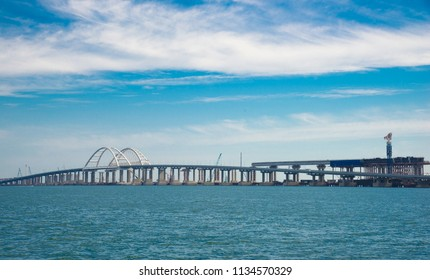 Kerch,Crimea - 07/08/2018: Photos of Crimean bridge  -   construction of  bridge  close up,  view from sea.  Crimean bridge from Taman Peninsula to Kerch Peninsula.