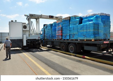 KEREM SHALOM, ISR - AUG 25:Truck full of goods to Gaza passing an X-Ray exam on Aug 25 2010.Since 2010, NIS 75M been invested to upgrade the crossing, which is capable of handling 450 trucks a day.