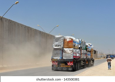 KEREM SHALOM, ISR - JUNE 21:Cargo in Kerem Shalom crossing on June 21 2009. The crossing used trucks carrying goods from Israel to the Gaza Strip. In 2012, the rate of traffic was 250 trucks a day.