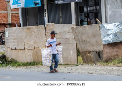 Kerinci, Jambi, Indonesia - December 14, 2020: cracker seller man by foot on the highway.