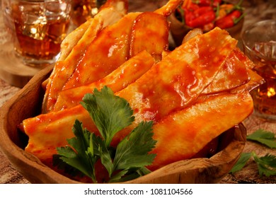 Keripik Singkong Balado. Traditional cassava crackers coated with red chili sauce from Padang, West Sumatra.