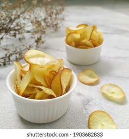 Keripik singkong. Cassava chips or tapioca chips is traditional snack from Java, made of cassava thinly sliced and fried.