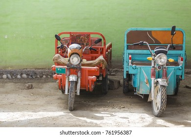 Keriya,China - October 04,2017: Dealers in the area park the motorcycles in the street on October 04, China.