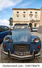 Kerkira, Corfu/Greece - August 24 2018: A French oldtimer classic car icon Citroen 2CV Special from 1990 parked in the characteristic streets of the Corfu. Automotive photo. Background with old car