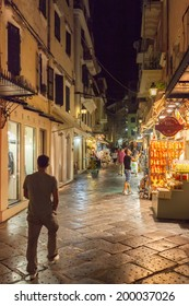 KERKYRA, CORFU, GREECE - SEPTEMPER 19 2013: Tourists walking and shopping on narrow streets in the historical Kerkyra city center in Corfu at night
