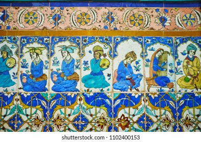 KERMAN, IRAN - OCTOBER 15, 2017: The element of wall decoration in Ganjali Khan Hammam (bathhouse) - the painted on tile medieval musicians with traditional instruments, on October 15 in Kerman.