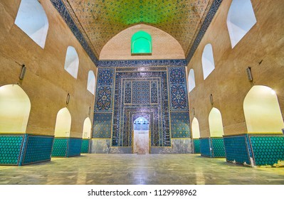 KERMAN, IRAN - OCTOBER 15, 2017: The tiled mihrab with fine floral patterns and Arabic calligraphy in summer prayer hall of Jame Mozaffari Mosque, on October 15 in Kerman.